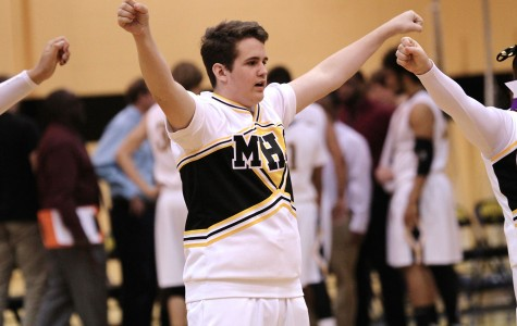 Sophomore J.R. Quidley performs with other members of the basketball cheerleading squad during the varsity boys game against Plymouth Jan. 7.