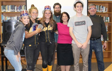 Faculty and student trivia members celebrate their victory. Students on the winning team were juniors Alex White, Meredith Booth and Fletcher Casey and senior Abby Haywood. Mike Phelan, Pat Holland and Stephen Nichols represented the MHS faculty.