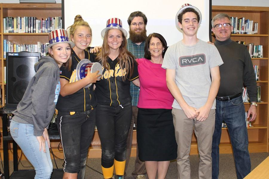 Faculty+and+student+trivia+members+celebrate+their+victory.+Students+on+the+winning+team+were+juniors+Alex+White%2C+Meredith+Booth+and+Fletcher+Casey+and+senior+Abby+Haywood.+Mike+Phelan%2C+Pat+Holland+and+Stephen+Nichols+represented+the+MHS+faculty.+