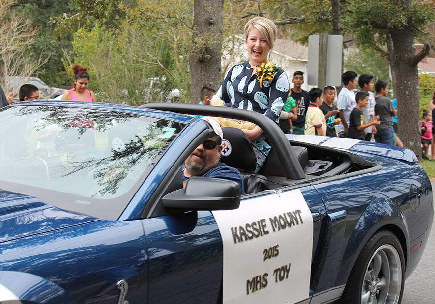 English teacher Kassie Mount makes her way through downtown Manteo during the school's Homecoming parade. Each year the school's TOY is recognized during the parade.