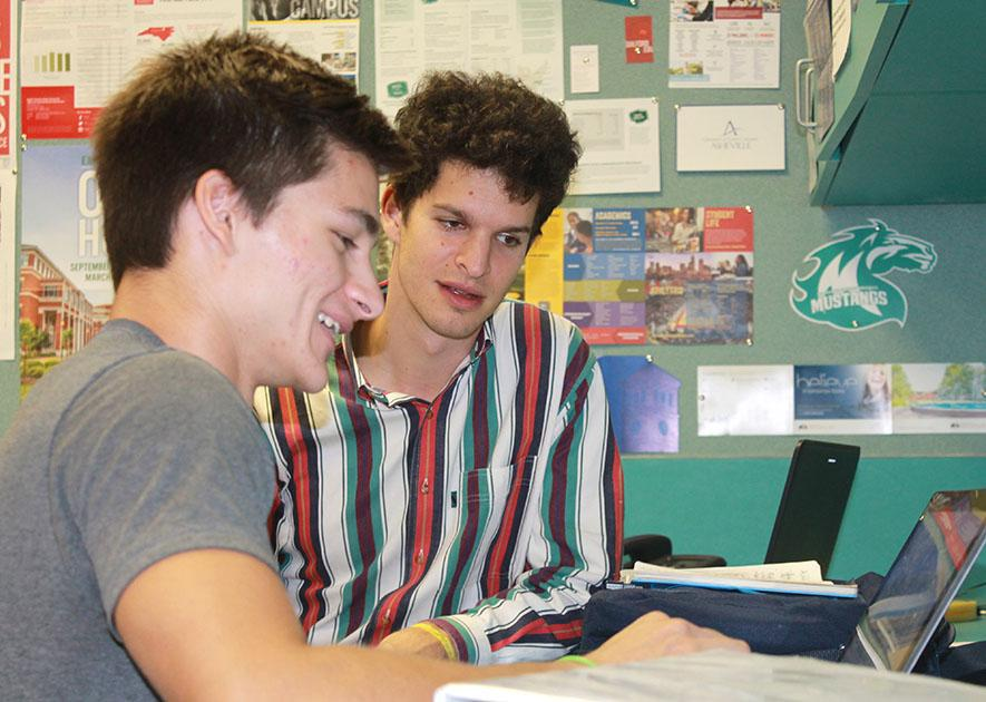 College+counselor+Seth+Rose+helps+senior+Luciano+Zottoli+with+a+college+application.+Rose%E2%80%99s+office+is+located+in+the+library%2C+and+he+is+at+MHS+on+Tuesdays+and+Thursdays.