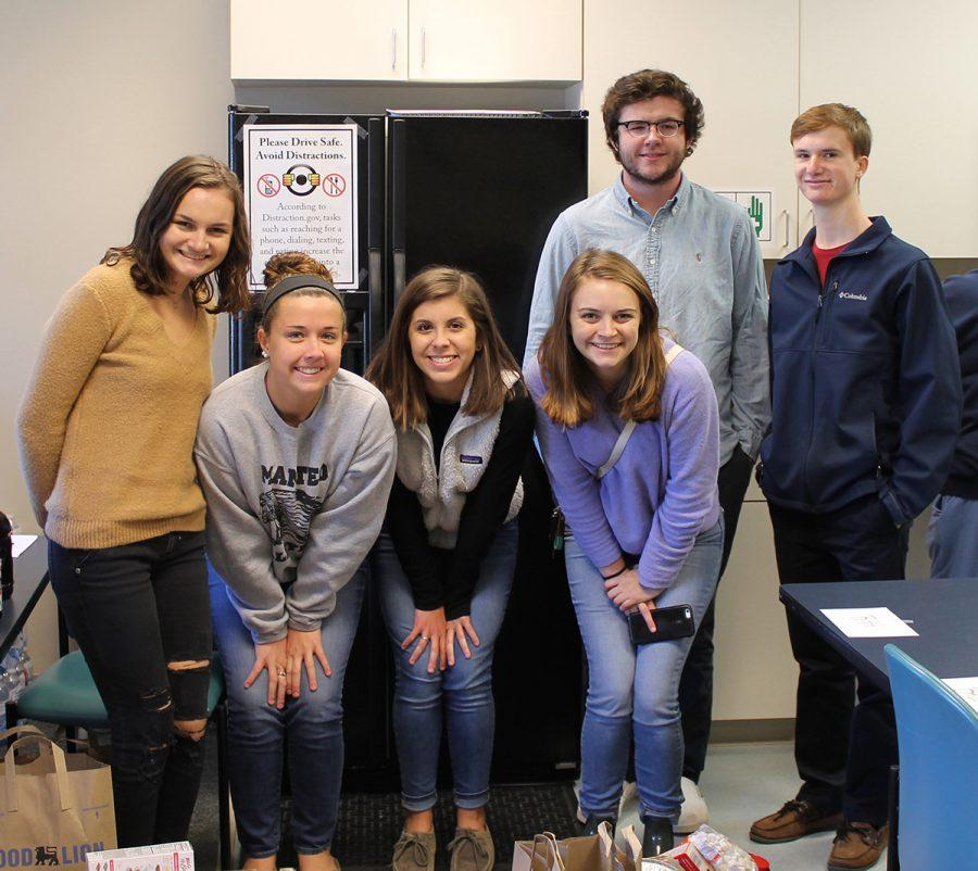 Members of SGA deliver thanksgiving baskets to social services.