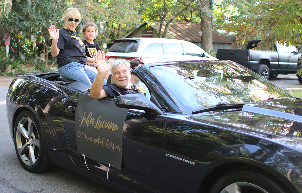 Principal John Luciano, his wife Gail and his granddaughter Sophia ride through downtown Manteo during the Homecoming parade Oct. 6.